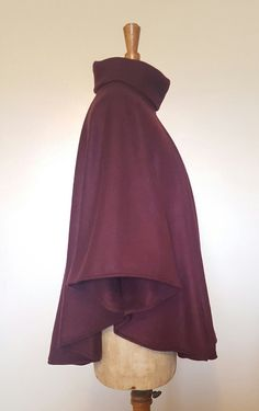 A lovely long soft cosy cape with a roll neck. Made from anti pill super soft fleece it is perfect for wearing over knits or jersey. This cape falls elegantly and has stitching to create draped sleeves, perfect for winter weather.  Available in one size only, fits up to size 16.  100% Polyester, wash at a low heat and dry flat.  All my items are designed and made in my home in Berkshire, creating new and interesting clothing with only a small number of each design made. From drafting the… Roll Neck, Cosy, Knits, Size 16, Jumper, Stitching, Weather, Flat, Knitting