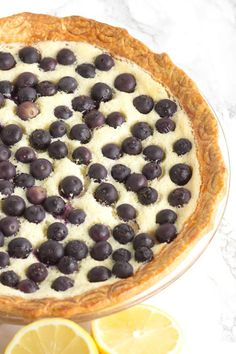 A simple lemon blueberry custard pie recipe with fresh blueberries scattered on top. Perfect summery dessert recipe and a delicious pie. Lemon Custard Pie, Blueberry Custard Pie, Blueberry Desserts, Köstliche Desserts, Delicious Desserts, Healthy Desserts, Tart Recipes, Best Dessert Recipes, Yummy Recipes