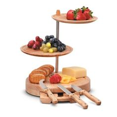 The 3-Tiered Cheese Board Server is a serving tray as well as a cheese board. This unusual, tiered wooden serving tower features a cheese board for cutting at the bottom, and 2 more layers for serving cheeses, fruits, and other foods.