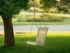 Forget that old tire swing! This is an old kitchen chair, given a fresh coat of paint, and used as a whimsical addition to an old tree.