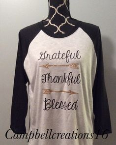 Grateful, thankful , blessed arrow raglan shirt is perfect for all year round. These shirts are unisex sizes and are so soft. These shirts are decorated with vinyl and heat pressed.