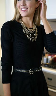 how to dress up a simple little black dress for the holidays! {layered gold dainty statement necklace, gold black braided waist belt, long sleeve fit and flare sweater knit skater dress}