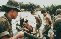 LARRY BURROWS Mekong Delta, Vietnam, 1963  South Vietnamese troops with  Viet Cong prisoners. (LIFE)