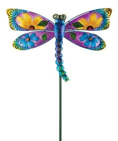 Plant colorful whimsy in the flowerbeds with this bright dragonfly garden stake that's made of metal with elegant glass detailing.