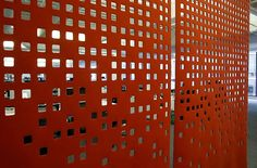 A red square panel separates one workspace from a meeting lounge at Square…