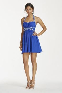 Flirty and fun, this crystal beadedhalter dressis sure to make Homecoming a night to remember!  Sweetheart halter bodice adorned with sparkling crystal beadingon thestraps and waist.  Short chiffon mini skirt adds movment with its soft pleats.  Designed by Masquerade.  Fully lined. Imported polyester. Back zipper. Professional spot clean.  Also available in Plus Sizes as Style 111432DW.