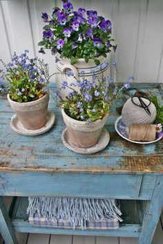 little blue potting table