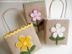 How adorable are these?!  Cover bags with cloth or jute and decorate with felt flowers, fruits, etc.