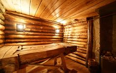 Traditional dry heat sauna in log hut with fold-down bench
