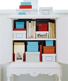 Use labeled boxes to house odds and ends without a home. | Find inspiration for your own shelves and bookcases in these great photos.