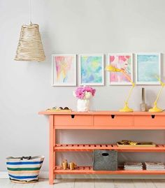 Colour hit the passage is a great area for experimental decorating. If you dont want to commit to painting an entire wall in a bold shade, paint furniture items instead. We can chose fabulous shade of coral to paint console with that the four watercolour artworks provide a subtle symmetry to soften the look - they are offset with a single lamp in a vibrant yellow to keep it from looking static.
