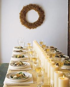 Simple Centerpiece idea... love the lines of white candles... Ikea has great pillar candles for so cheap, this could be a good idea!