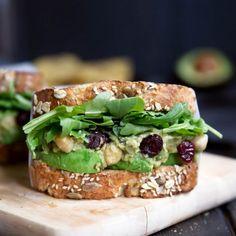 Incredible vegetarian smashed avocado chickpea salad sandwich. No mayo thanks to the creamy, ripe avocado. Plus cranberries + lemon!