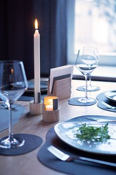 Restaurant table setting. Table mats and candle holders.