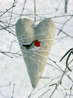 Bela Stitches' cross stitch robin on linen