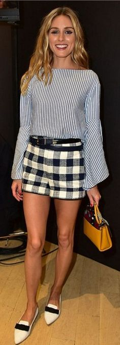 Olivia Palermo: Shorts and shirt – Zara  Belt – Reiss  Shoes – Jimmy Choo  Purse – Paula Cademartori