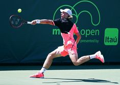 Denis Shapovalov Photos - Denis Shapovalov of Canada serves against Damir Dzunhur of Bosnia and Herzegovina during Day 6 of the Miami Open at the Crandon Park Tennis Center on March 24, 2018 in Key Biscayne, Florida. - Miami Open 2018 - Day 6