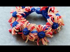 Monster Tail MACRO DAISY FLOWER Part 1. Designed and loomed by YarnJourney. Click photo for YouTube tutorial. 06/27/14.