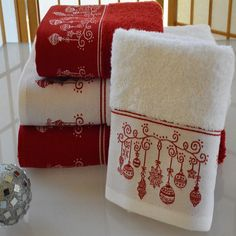 Bring comfort home for the holidays. This 2-piece towel set features a beautiful Christmas ornament design and are crafted from absorbent 2-ply 100-percent Turkish cotton.