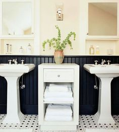 Pair of Pedestal Sinks-This simple arrangement of pedestal sinks and matching mirrored medicine cabinets is a great solution for a modest-size bathroom. They take very little space and leave room for the other, larger pieces. Wainscoting keeps the otherwise simple space from being too plain.