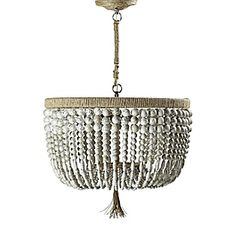 """Malibu Chandelier - beaded lighting - """"Strands of bone-colored beads with subtle bronze veining bring an earthy glamour to any space. The sturdy steel frame is wrapped in natural hemp with a perfectly frayed tassel, adding to the rustic appeal."""""""