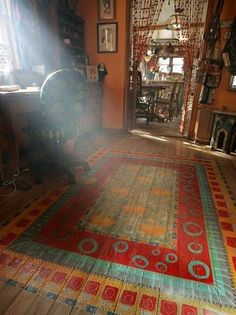 Painted wood floors...yes - it's not a rug! Beautiful light.