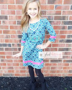 Gorgeous blue dress with pattern accents in the perfect shade of pink! Pockets are a plus, as are the marching leggings that come with..