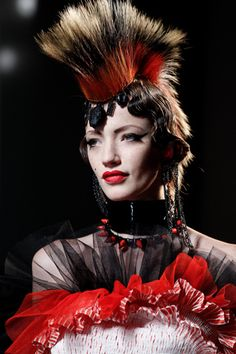 "After working for Pierre Cardin and Jean Patou, Jean Paul Gaultier set out on his own to create a womenswear line. The label's gender-bending, deconstructed aesthetic, and risqué collaborations—like Madonna's infamous cone-shaped bra for the 1990 Blonde Ambition tour—gave the designer his ""enfant terrible"" reputation. He's also known as one of the industry's master tailors, with a knack for tuxes, trenches, and leather, and a tendency to embrace equestrian, military, and royal tropes."