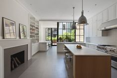 O'neill Rose West Side Townhouse, L-Shaped Kitchen with island, white subway tiles | Remodelista