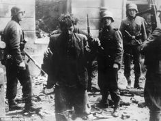 Hunting refugees: Two Jewish resistance fighters are arrested by German troops in Poland, 1943
