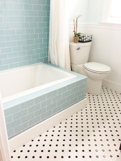Large vapor glass subway tile bathtub surround Tile outlet. Color: Vapor