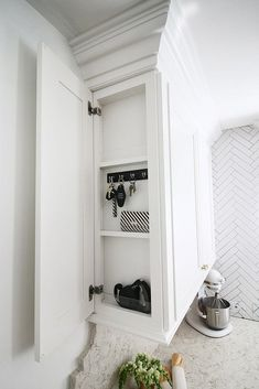 Imagine never losing your keys again! Kristin at The Hunted Interior created a shallow cabinet on the side of her corner kitchen cabinet for exactly that purpose.