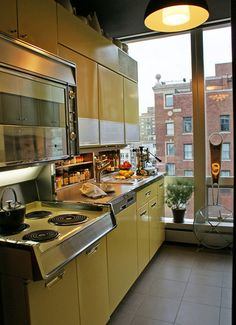 Lovely mid-century style kitchen with metal cabinets