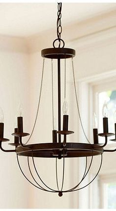 Ballard Design - This chandelier has the traditional shape made from minimal thin metal so it isn't as visually heavy. I would probably finish it with a rusted paint finish to push it further to the rustic side.