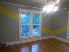 Diagonal yellow stripes on gray walls by Lezley Lynch Designs, Edmond, OK.