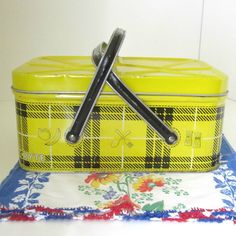 Vintage Tin Picnic Basket Tin Box Yellow and Black Plaid 1950s Metal Picnic Nesco. $48.00, via Etsy.
