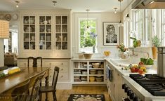 Large White Built In And Open Low Shelf - An all-white design is warmed by rustic hardwoods and visually interesting built-ins