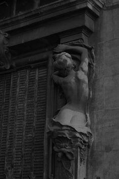 Caryatid high-relief sculpture
