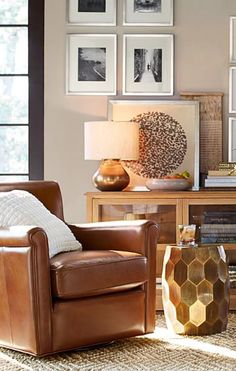 Corner Inspiration: Nothing beats the comfy, leather chair and good book combo. Every living room needs a spot like this!