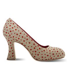 Sport a shoe fit for a picnic in Tuscany with this classic and adorable pump. Striking red dots are painted onto the natural linen surface, while the inside is lined with soft leather. 3.5'' heel with 1'' platformLinen upperLeather liningLeather outsole