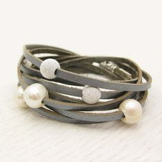Sterling Silver Pearl and Leather Wrap Bracelet / Fresh Water Pearl & Eco Friendly Leather / romantic dreamy ocean wedding star inspired. $97.00, via Etsy.