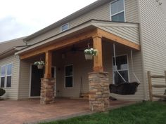 Covered porch all cedar trim and cedar tongue and groove ceiling with stone columns,ceiling fan, can lights, flood light, outdoor sound system, sealed and stained with cabots Australian oil