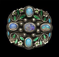 ARTHUR & GEORGIE GASKIN 'Rose Lattice' Arts & Crafts Brooch  Silver Enamel Opal H: 3.5 cm (1.38 in)  W: 3.6 cm (1.42 in)  Marks: Signed 'G' verso British, 1912