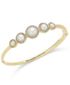 """Imitation pearls ringed with pave crystals couldn't be any more perfect in this hinged bangle bracelet from kate spade new york. Set in gold-tone mixed metal. Approximate diameter: 2-1/2"""". 