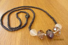Necklace with faceted czech glass beads and brown wood beads.  $30 www.etsy.com/shop/casanoni