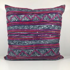 Vintage Hmong Indigo Embroidered Pillow  These pillows are made from vintage batik indigo with intricate, colorful embroidery. These fabrics come from the Hmong hill tribe in Northern Thailand, often made from scraps from traditional Hmong dresses. -Size: Approx. 20 x 20  -Invisible zipper closure -Insert not included. We recommend using an insert 1-2 larger than the cover -Spot or dry clean only Because these pillows are made by hand using vintage materials, each may have a slight…
