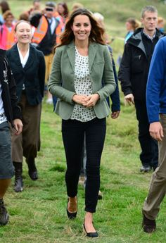 Kate Middleton looked regal in a recycled Zara top just five weeks after giving birth to baby Prince George. She pairs the printed top with a sage green blazer, blank pants, and black flats.