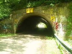 In Chillicothe, Ohio, the Schrader Road Tunnel is believed to be haunted by a woman and her child who died inside this tunnel. The manner of death depends on who you ask. There are plenty of paranormal reports here. If you drive through the tunnel with your lights off & windows rolled down you can hear the cry of a baby, hand prints are found on the back of the car, strange sounds, apparition of a woman, laughter of children, cold spots & a dark figure with red eyes....