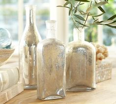 Bubble Mercury Glass Bottles- Set of 3 - These are so gorgeous in person.