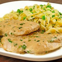 Boneless chicken breasts, sauteed in butter and topped with creamy pan sauce flavored with white wine, fresh tarragon and Dijon-style mustard are served alongside egg noodles tossed with butter, peas and fresh parsley.